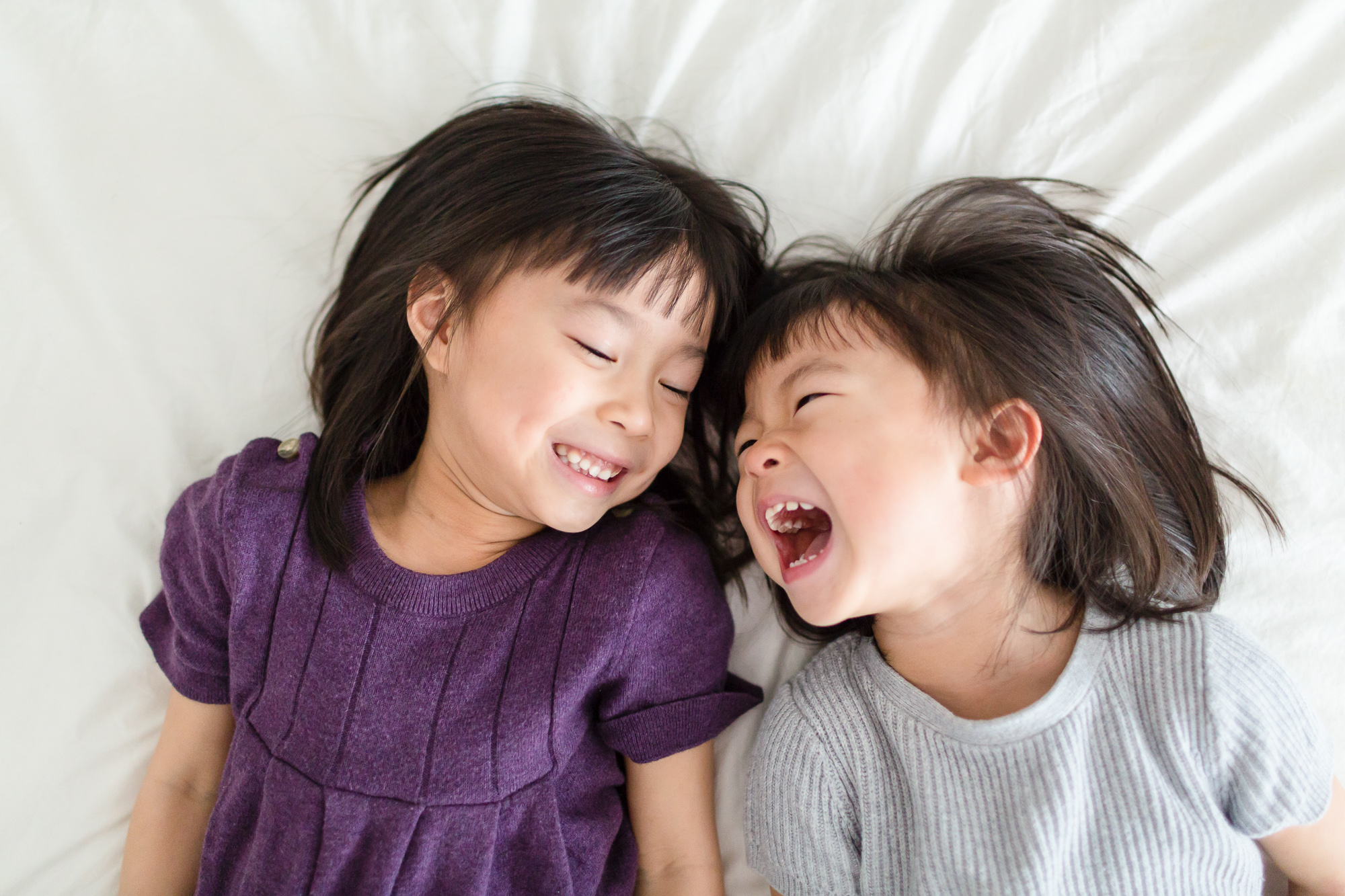 Two sisters laughing together