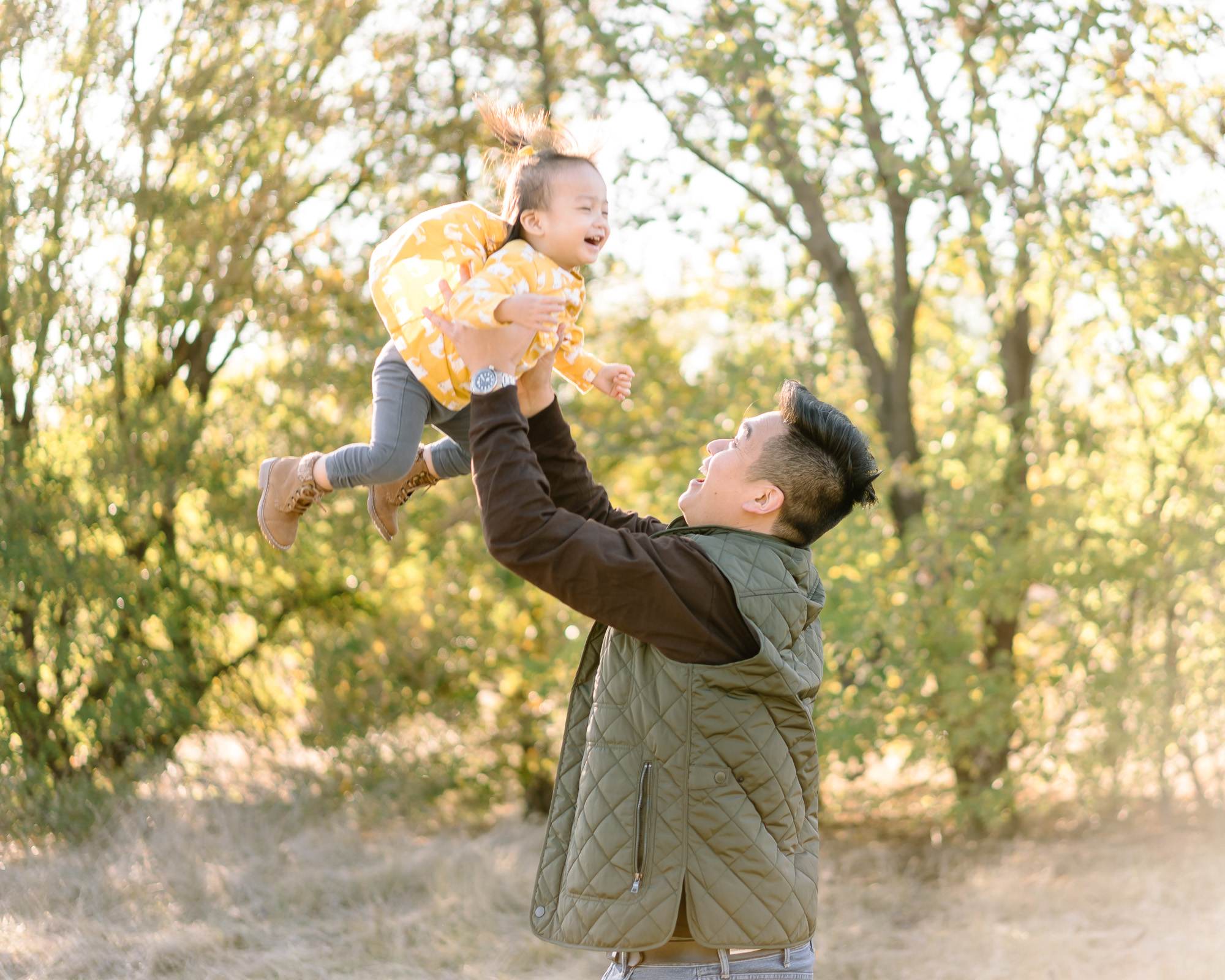 Father lifts his daughter in the air