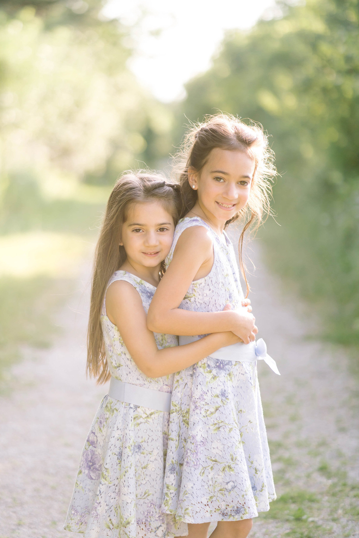 Two sisters hugging each other.