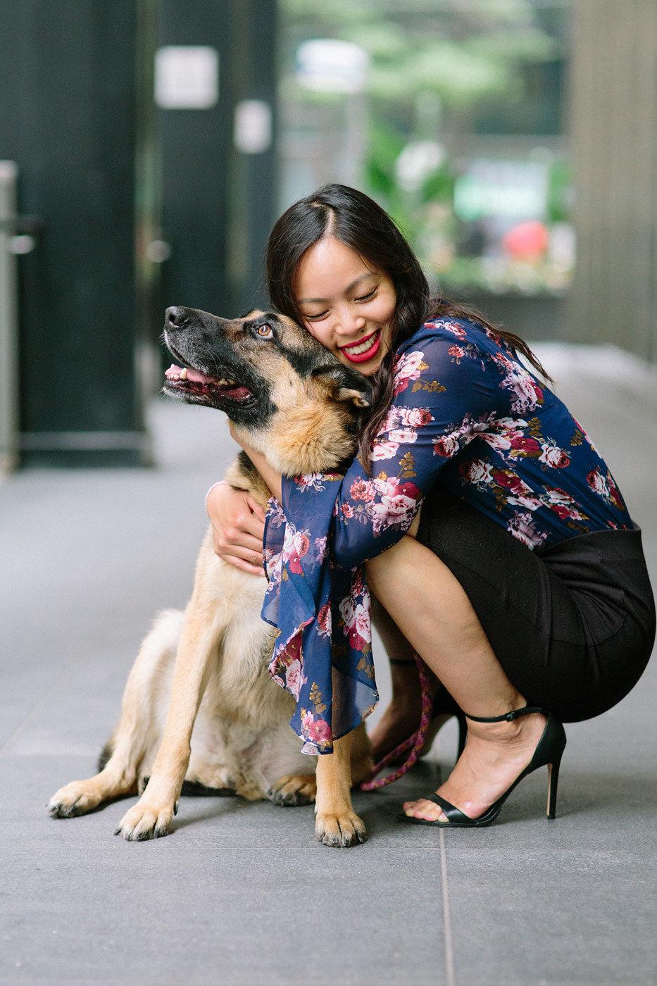 Young Asian female hugging her German Shepherd dog in downtown Toronto.